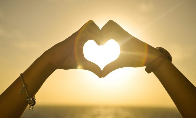 sun shinning through two hands shaped heart header graph for good by mark february 2020