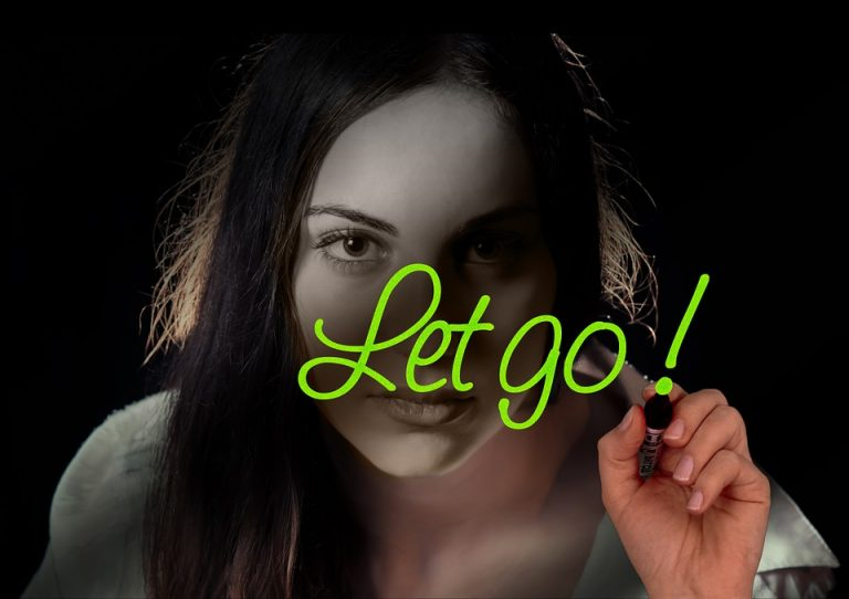 Featured photo for Why can't I let go? Girl with a green marker with the words Let Go