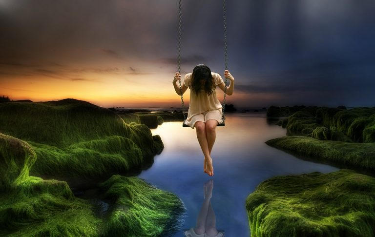 orphaned again why me sad girl swinging over water