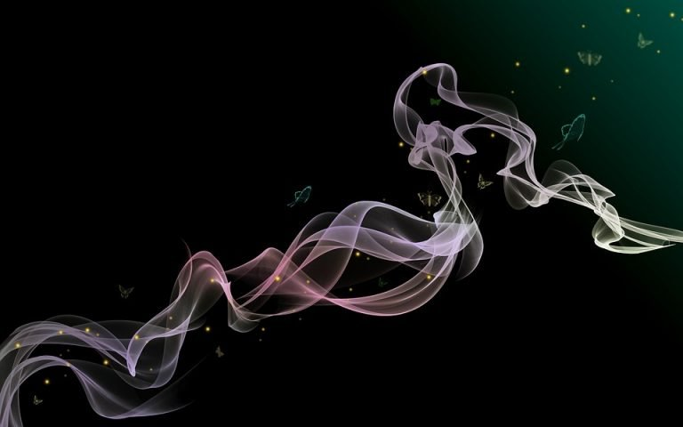 Swirling Smoke with butterflies fluttering about on a black back ground. The smoke represents evanescing into thin air.